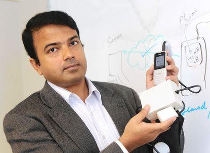 Soumyadipta Acharya, a Johns Hopkins professor, shows off HemoGlobe, a device that can test for anemia.