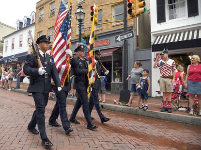 The Annapolis Police Honor Guard marches in the parade as they make their way down Main Street. The City of Annapolis held their Fourth of July Parade. This year's celebration has been canceled due to coronavirus.