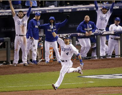 Kansas City Royals' Alex Gordon celebrates a solo home run off New York Mets relief pitcher Jeurys Familia during the ninth inning of Game 1 of the World Series on Tuesday, Oct. 27, 2015, in Kansas City, Mo.
