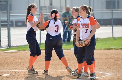 The Reservoir softball team, seen celebrating an out in this file photo, earned a 5-4 victory over Mt. Hebron on Friday.