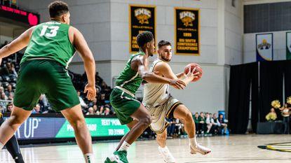 UMBC sophomore guard Joshua Rosario (driving with the basketball) had initially committed to a Division II school near his hometown of Miami to be closer to his father Carlos Rosario Sr., who was fighting for his life less than two years ago.