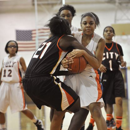 City's Briana Carrington, left, wrestles for the ball with Poly's Jayda Pearson during the first half.
