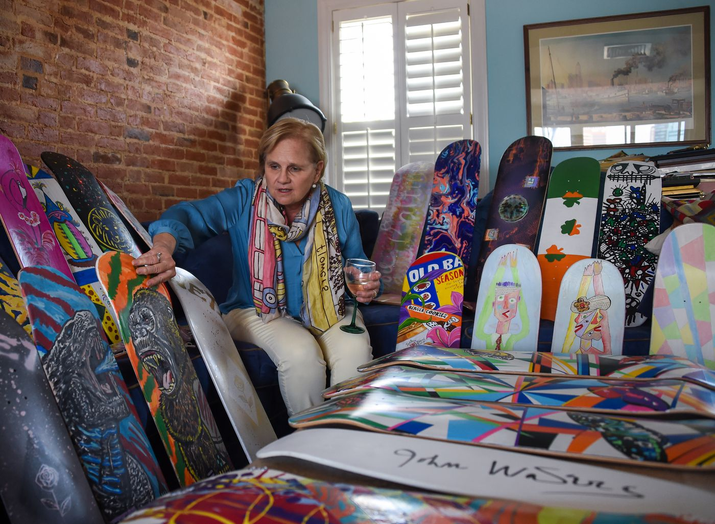 Cindy Conklin displays some of the painted skateboard decks in her home on Wednesday, April 7, 2021; the art pieces will be auctioned off to help fund the completion of Jake's Skate Park at Rash Field.