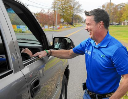 Barry Glassman, who was elected Harford County's next county executive, shares a laugh with a friend across from the Level Fire Hall on Election Day Tuesday.