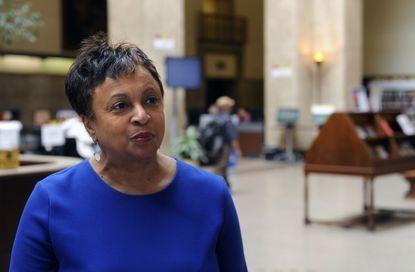 Carla Hayden, CEO of the Pratt Library, gives a tour of the library's central branch.