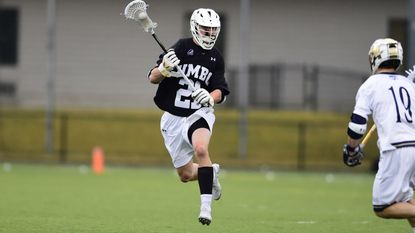 Senior Gunnar Schimoler (pictured in 2018) has lined up as an attackman, offensive midfielder and short-stick defensive midfielder. This spring, he is a starting defenseman for the UMBC men's lacrosse team.