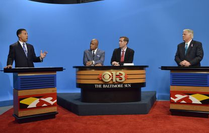 Democratic candidate Lt. Gov. Anthony G. Brown and Republican candidate Larry Hogan spar during the first gubernatorial debate, moderated by WJZ anchor Vic Carter, and Baltimore Sun Editorial Page Editor Andrew A. Green.