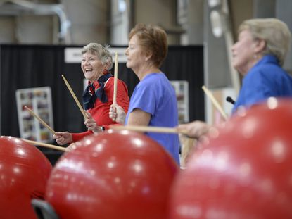 From left, Diane McPhillips, Marie Anderson and Shirley Freeland perform with Drums Alive, a musical fitness group from Carroll Lutheran Village during Wednesday's Seniors on the Go Expo at the Carroll County Agriculture Center in Westminster Sept. 15, 2021.