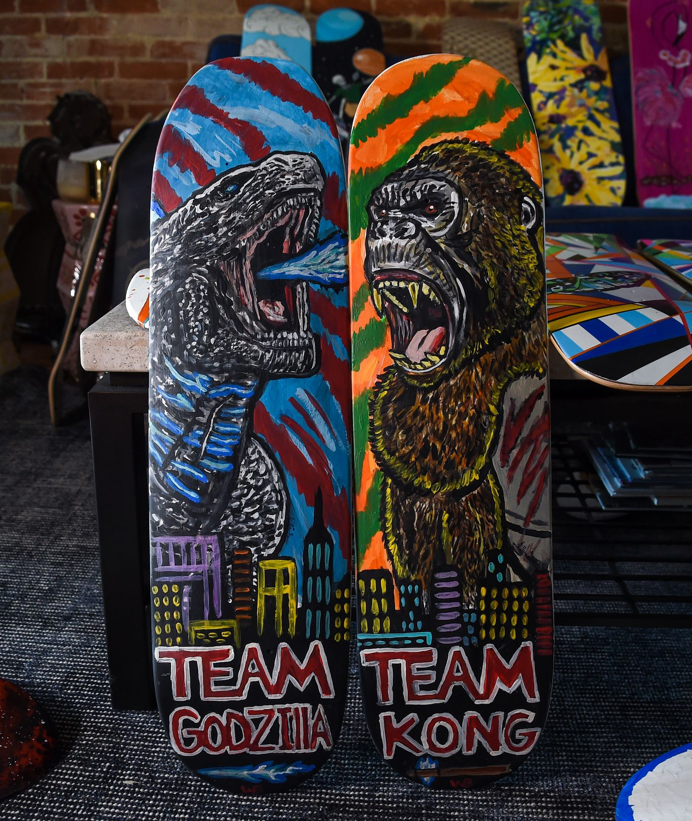 Skateboard decks featuring images of Godzilla and King Kong by Will Brown (IG: @artistwillbrown) sit in the living room of Cindy Conklin on Wednesday, April 7, 2021; the art pieces will be auctioned off to help fund the completion of Jake's Skate Park at Rash Field.