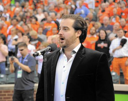 Rolando Sanz performs the National Anthem prior to game one of the ALDS.