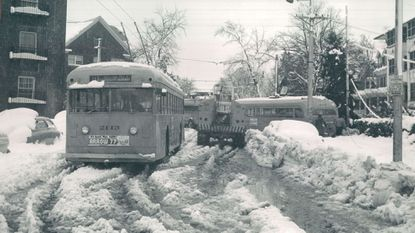 Transit traffic jam at Roland and University Parkway. Transit bus stuck in the snow.