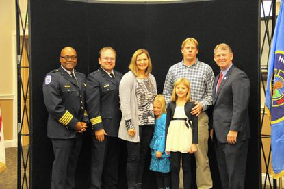 Alexandra Orange, 9, proudly holds her Gift of Life award alongside her mother and father, Kristina and Chris, little sister, Julianna, as well as HCDFRS Fire Chief John Butler, left, Dr. Matthew Levy, and County Executive Allan Kittleman during the department's award ceremony Wednesday morning in Clarksville.