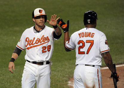 Steve Pearce, left, and Delmon Young, shown in an August game against Tampa Bay, are expected to share time at designated hitter with a number of Orioles.