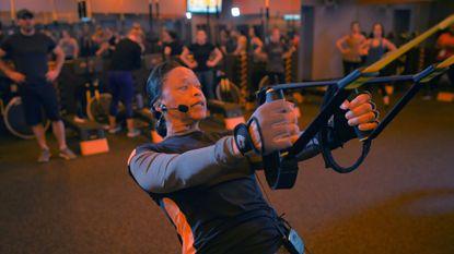 Coach Lane Cobb instructs her class at Orangetheory, an interval fitness training destination.