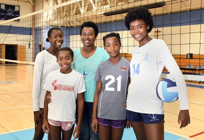 Ebere Onukwugha, center, has encouraged a love for the sport of volleyball with her four daughters: Kelenna, 14, Chika, 9, Chioma, 11, and Chidinma, 16.