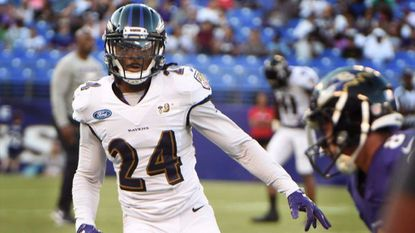 Ravens cornerback Brandon Carr practices on Sunday at M&T Bank Stadium, the team's first open practice for fans.