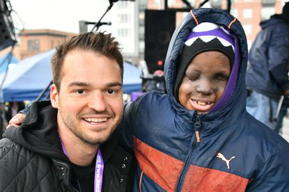 Orioles player Trey Mancini with sports superfan Mo Gaba at the BMORE Around Town #Purple tailgate party. Gaba, 13, an avid Baltimore sports fan, is battling cancer for the fourth time. Proceeds from the event will help fund his medical treatment.