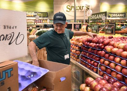Sprouts employee Chris Scroggins stocks some fresh apples in the large fresh produce area in preparation for the opening of the new Sprouts Farmers Market store in the Tollgate Marketplace in Bel Air. The store officially opens at 7 a.m. Wednesday, July 10.