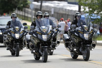 Maryland State Police troopers ride atop motorcycles outside of Fort McHenry National Monument and Historic Shrine, where President Donald Trump attended a Memorial Day ceremony on Monday, May 25, 2020, in Baltimore. (AP Photo/Julio Cortez)