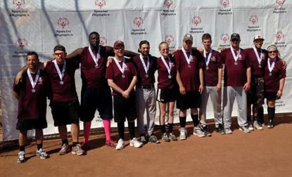 """Carroll County Special Olympics Softball team recently went to Witicha, Kansas this past week and competed with over 30 teams from across the US and Canada, at the Special Olympics North America Softball Championship. The Tigers won a silver medal in the Western Division. The """"Unified"""" team is made up of both Special Olympics athletes and their partners. Pictured right to left: Ryan Chernock, James Fanwell, Daniel Graham, Derek Hamburg, Lucas Lichtenberg, Mary Linthicum, Peter Linthicum, Brendan Rost, Todd Rost, Ryan Whittaker, Amanda Zier. Not pictured: coach Kerri Dean."""
