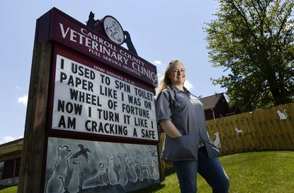 Lynn Wimmer, DVM, outside the Carroll County Veterinary Clinic Wednesday, May 13, 2020, whose sign has entertained motorists driving on Md. 140 for years, has moved, along with its weekly groaner, to a new location along Baltimore Boulevard in Westminster.