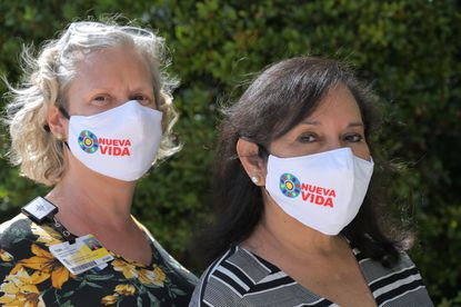 Tori Lewitt (left), oncology outreach program manager, and Sandra Villa de León, Baltimore program manager for Nueva Vida, a nonprofit that provides cancer support services to the Latinx community in the Baltimore area, at St. Joseph Hospital Cancer Institute.