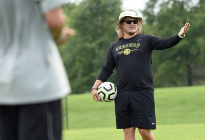 Trey Howes, Century's new boys soccer head coach, gives instruction to his players as they prepare for a drill during a practice at the school on August 15.