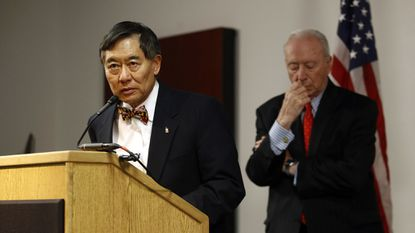 University of Maryland president Wallace Loh, left, speaks at a news conference in front of James Brady, chairman of the University System of Maryland Board of Regents, following the board's recommendation that football head coach DJ Durkin retain his job, Tuesday, Oct. 30, 2018,
