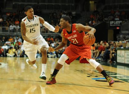 Pe'Shon Howard is pressured by Miami guard Rion Brown.
