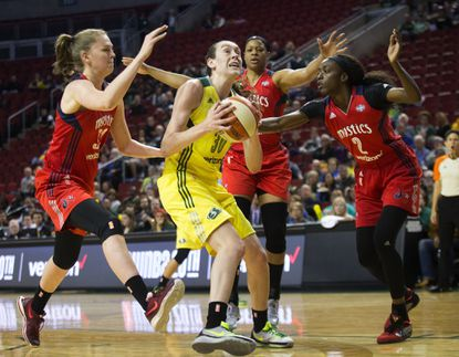 Seattle Storm forward Breanna Stewart gets swarmed by Washington Mystics guardEmma Meesseman, left,centerKia Vaughn and guard-forward Kahleah Cooper during the first half of Washington's 84-82 overtime victory.