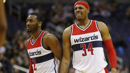 Washington Wizards players John Wall, left, and Paul Pierce.