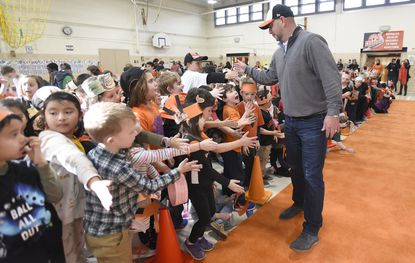 Orioles manager Brandon Hyde greets students during an Orioles rally at Timonium Elementary School on Friday.