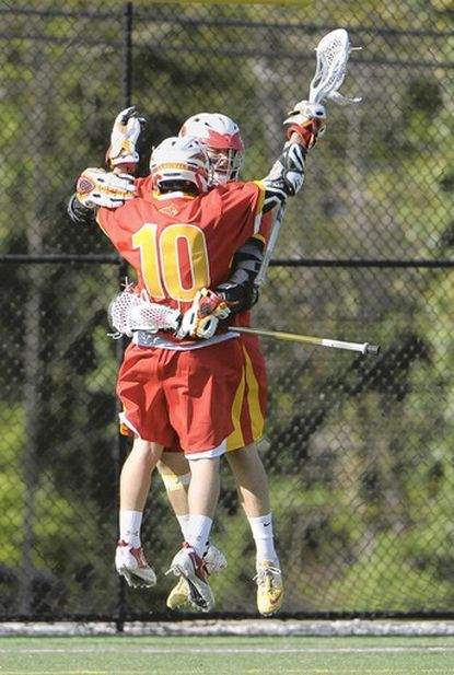 Calvert Hall junior attackman Jordan Germershausen, front, celebrates a goal against Boys' Latin in April with senior teammate Ryan Brown. Germehausen will play for the Baltimore All-Stars and Brown will play for the South All-Stars in the Under Armour lacrosse games at Towson University that begin June 29.