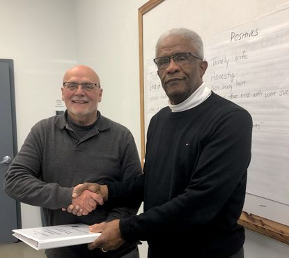 Rev. Chester France, right, is the founder and chairman of Lifting Labels. At left is one of the nonprofit's board members, Allen Holsopple. The organization hopes to launch its apparel manufacturing operation in January.