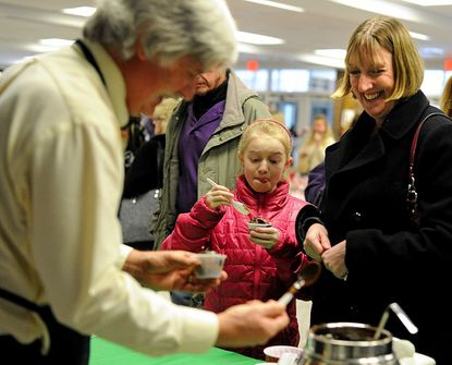 Anne McKenzie and her daughter, Colleen McKenzie, 11, sample chocolate ice cream during the chocolate festival at Westminster High School Feb. 2.