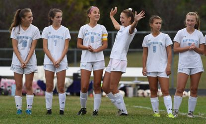 Westminster's Emily Crowder entertains her teammates during players introductions before a girls soccer game at Winters Mill High School on Saturday, October 12.