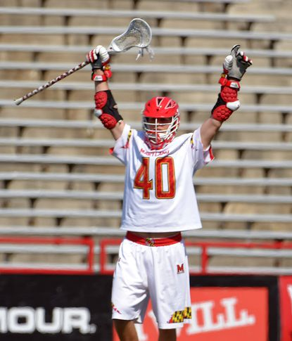 Maryland midfielder Connor Kelly (40) reacts after feeding midfielder Colin Heacock, who scored the team's seventh goal against the North Carolina Tar Heels during the third quarter in College Park. Maryland defeated the Heels, 11-8.