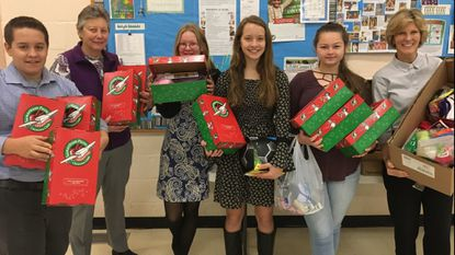 Pasadena United Methodist Church youth participate in Operation Christmas Child, a program filling shoeboxes with goodies and sending them to children around the world. The church is celebrating its 100th anniversary this weekend.