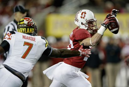 Maryland outside linebacker Yannick Ngakoue chases down Stanford's Christian McCaffrey during the Foster Farms Bowl.