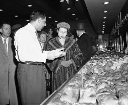 Queen Elizabeth II stops at a store on Oct. 19, 1957, and listens to a description from assistant manager Donald D'Avanzo. The Queen and Prince Philip, returning to Washington from the University of Maryland-University of North Carolina football game at College Park, visited the store, poking into baskets, admiring steaks and questioning customers about their shopping habits. What was the store?