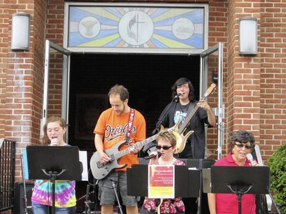 The contemporary musical group Rejuvenate performs at Arnolia United Methodist Church's recent fall flea market. From left are Allison Nelson, Andrew Virgilio, Sherry Disharoon, Jarrett Rettman and Beth Krebs. The group will perform at a coffee house to be held Nov. 9 from 6-8 p.m. at the church located at 1776 E. Joppa Road.