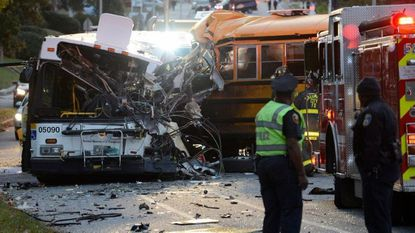 Fire department and rescue officials at the scene of a 2016 bus crash on Frederick Avenue between Monastery Avenue and Morley Street between a school bus and city bus. Six people died and 11 were injured.