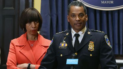 Mayor Catherine E. Pugh listens as new Baltimore Police Department Commissioner Darryl De Sousa makes remarks at City Hall. The mayor replaced Kevin Davis on Friday.