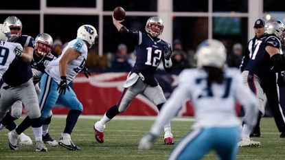 New England Patriots quarterback Tom Brady (12) wore red Under Armour cleats in the divisional playoff victory against the Tennessee Titans on Jan. 13 in Foxborough, Mass.