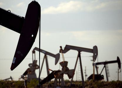 In this April 24, 2015, file photo, oil pumpjacks work in a field near Lovington, New Mexico. The Biden administration has approved thousands of drilling permits since taking office despite a campaign pledge to end fracking on federal land. (AP Photo/Charlie Riedel, File)