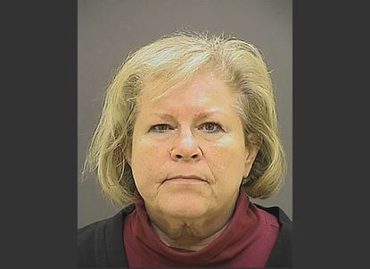 This photo provided by the Baltimore Police Department shows Bishop Heather Cook. Maryland's second-highest ranking Episcopal leader and the first female bishop in her diocese was charged with drunken driving and manslaughter, accused of fatally striking a cyclist in late December.