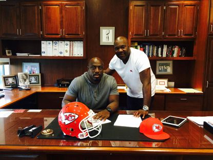 NFL agent Greg Barnett, right, after his client, Kansas City's Justin Houston, signed the largest contract for a linebacker in league history.