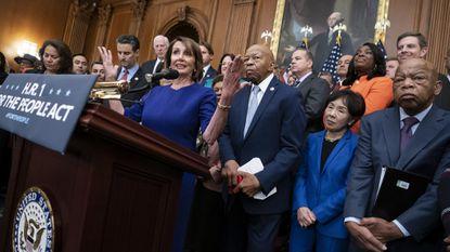 "Speaker of the House Nancy Pelosi called Rep. Elijah Cummings, standing to Pelosi's left, ""my brother in Baltimore."" Cummings died early Thursday. (AP Photo/J. Scott Applewhite)"