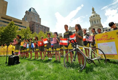 """26 teens are cycling across the country from Los Angeles to draw attention to the persecution of the Falun Gong in China. A rally is held at War Memorial Plaza in Baltimore before the """"Ride to Freedom"""" cyclists finish with a large rally in D.C."""