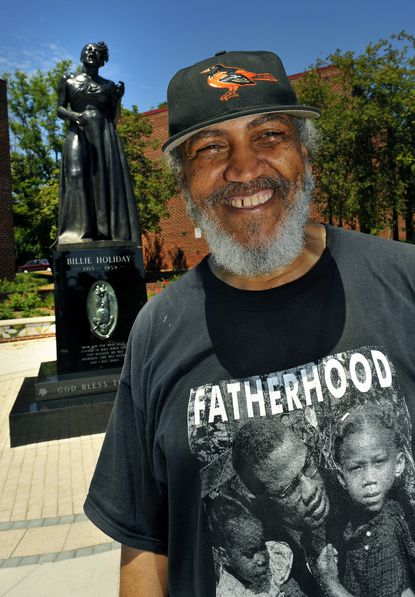 Baltimore sculptor James Earl Reid pictured in front of his Billie Holiday statue.